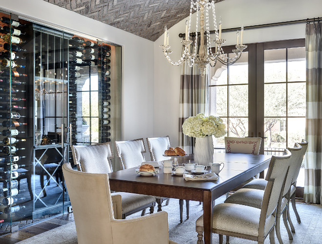 Glass enclosed wine cellar. Dining room with vaulted herringbone brick ceiling, French doors and custom glass enclosed wine cellar #Glassenclosedwinecellar #glasswinecellar Kim Scodro Interiors