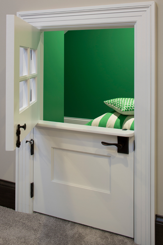 Grassy Fields 2034-30 Benjamin Moore, The lower level kids' play space under the stairs feature a custom dutch door, The green walls are painted in Grassy Fields 2034-30 Benjamin Moore Grassy Fields 2034-30 Benjamin Moore Paint Color, Grassy Fields 2034-30 Benjamin Moore #GrassyFields203430BenjaminMoore GrassyFieldsBenjaminMoore Grace Hill Design