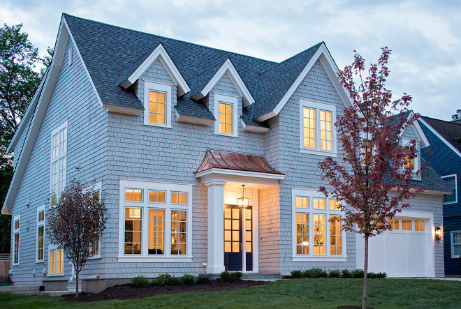 Grey Shingle style home. Grey Shingle style home with copper roof detail and navy front door. Grey Shingle style homes Grey Shingle style home #GreyShinglestylehome. #GreyShinglehome #Greyhome #Shinglestylehome Martha O'Hara Interiors. John Kraemer & Sons
