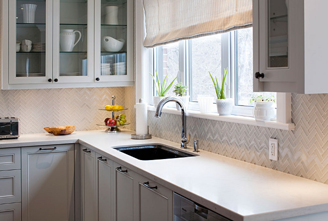 Herringbone backsplash. Herringbone tile backsplash. The herringbone tile backsplash is 3x1 herringbone backsplash in polish and hone glass. Countertop is Ceasarstone London Grey. #herringbone #backsplash #tile #CeasarstoneLondonGrey Hardcore Renos.