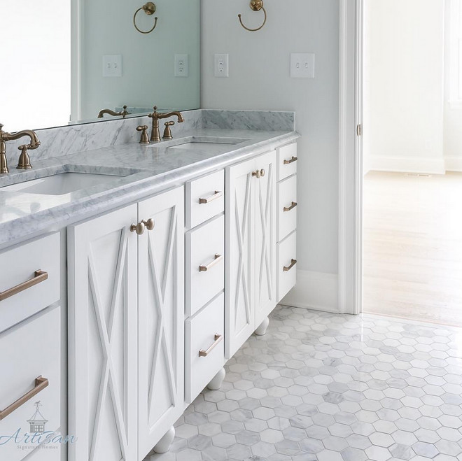 Hex Carrara marble tile on the floor. Master bathroom with white cabinet, brass and hex Carrara marble tile on the floor. #hexCarraramarbletile #hexCarraratile #bathroomfloor Built by Artisan Signature Homes. Interior Design by Gretchen Black from Greyhouse Design