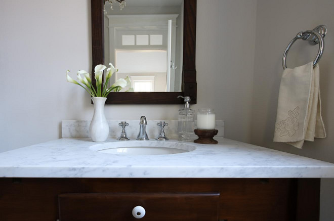 I repurposed an antique kitchen table and made it into a vanity, with a custom honed marble countertop. Beautiful Homes of Instagram @greensprucedesigns