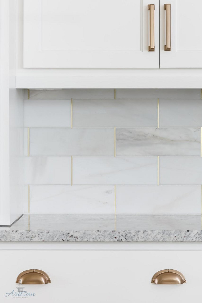Kitchen Backsplash. Kitchen backsplash is honed marble by the Tile Shop with brass schluter strips. #KitchenBacksplash #Kitchen #Backsplash #honedmarbletile #TileShop #brassschluterstrips Built by Artisan Signature Homes. Interior Design by Gretchen Black from Greyhouse Design