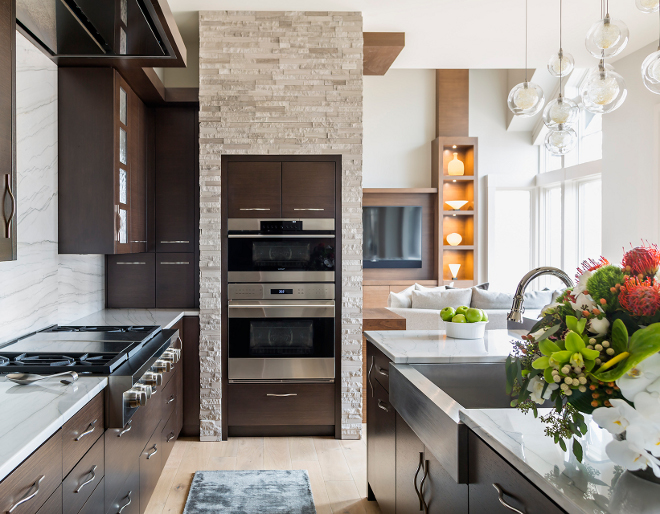 Kitchen Wall Oven, Wall Oven,The wall oven features stone and walnut cabinetry, Kitchen Wall Oven Ideas #KitchenWallOven #WallOven Hendel Homes
