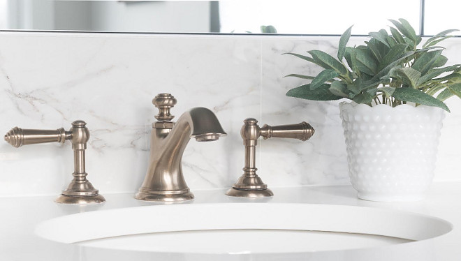 Bathroom faucet Kohler Artifacts, Brushed Bronze, w/ Lever Handles. Beautiful Homes of Instagram @greensprucedesigns