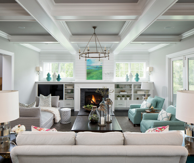 Living room with shiplap fireplace, half wall cabinets, window above cabinets and coffered ceiling #Livingroom #shiplap #Shiplapfireplace #halfwallcabinets #windowabovecabinet #cofferedceiling Grace Hill Design