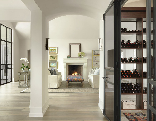 Living room with walk in wine cellar with black steel doors. Living room with walk in wine cellar with black steel doors. #Livingroom #walkinwinecellar #winecellar #blacksteeldoors #winecellarblacksteeldoor.