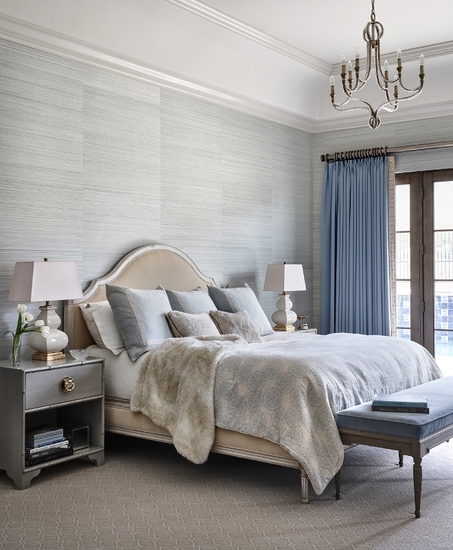 Master bedroom. Master bedroom features a grey wallpaper, a French beaded chandelier and a bench at the end of the bed #Masterbedroom #Masterbedroomdesign #greywallpaper #Frenchbeadedchandelier #benchattheendofthebed Kim Scodro Interiors