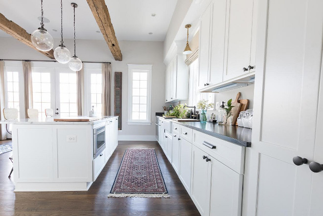 Modern Farmhouse Kitchen. Modern White farmhouse kitchen Modern White farmhouse kitchen with reclaimed wood beams and vintage kitchen runner. #ModernWhitefarmhousekitchen #Modernfarmhousekitchen #farmhousekitchen #farmhousewhitekitchen  Beautiful Homes of Instagram @greensprucedesigns