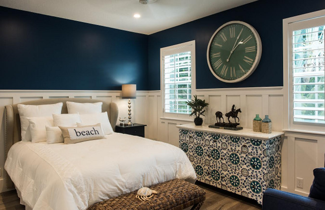 bedroom color scheme with navy walls and white board and batten wall