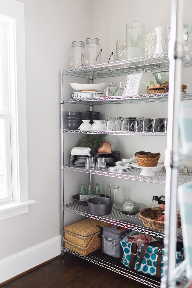 Pantry shelves. Pantry shelves. Affordable pantry shelves from Home Depot. We used chrome shelving to display our serving dishes and canvas baskets to house our food. I love that everything is on display, it gives the space a fun bakery feel. #pantryshelves Beautiful Homes of Instagram @thegraycottage