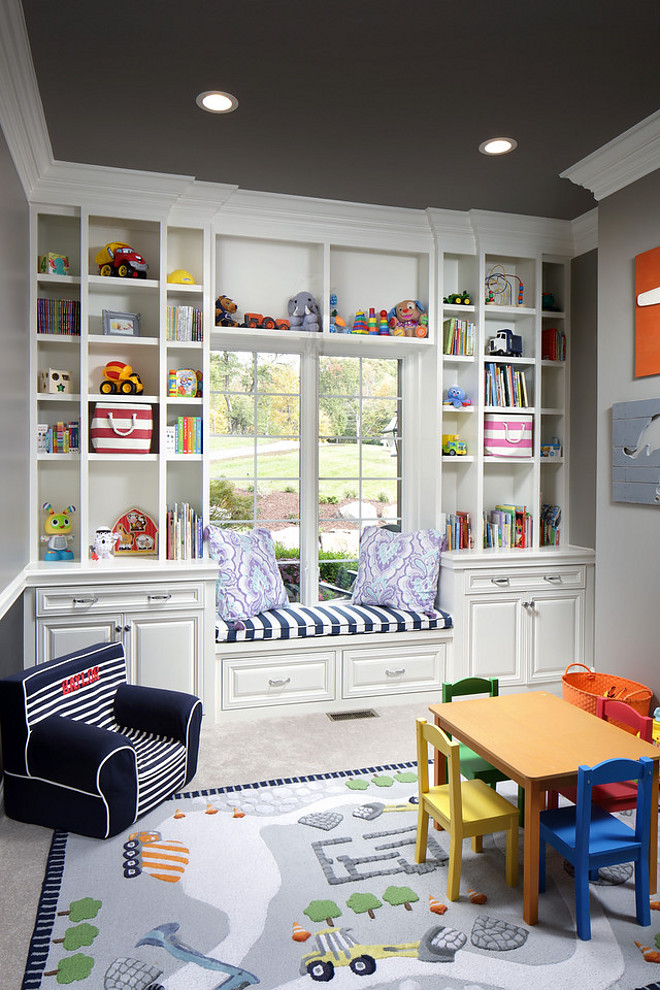 Playroom Cabinet and open shelves. This playroom features a custom cabinet with open shelves, drawers, doors and a window seat. Playroom Cabinet and open shelves. #PlayroomCabinet #Playroom #Cabinet #openshelves #storage Barrington Homes Inc.