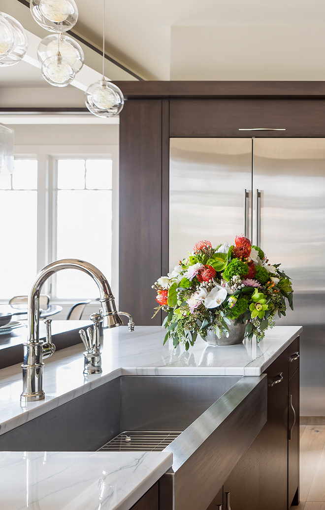 Polished Nickel Kitchen Faucet and Stainless Steel Farmhouse Sink. Polished Nickel Kitchen Faucet and Stainless Steel Farmhouse Sink Ideas #PolishedNickelKitchenFaucet #KitchenFaucet #StainlessSteelFarmhouseSink #FarmhouseSink Hendel Homes