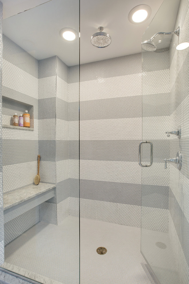 Striped White and Grey Penny Round Shower Tile. White and grey penny round tiles create a fun striped pattern in this shower. Striped White and Grey Penny Round Shower Tiles. Tile (White Shower Walls & Floors): Penny Round Bay Glazed, Bright White (with grey grout on walls and white grout on floor). Grey Tile: AU Penny Rounds BRP 3030 #StripedWhiteandGreyShower #Showertile #stripedshowertile #PennyRoundShowerTile #PennyRoundTile Revision LLC