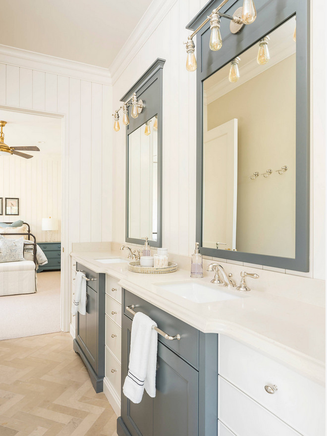 Two toned bathroom cabinet. Similar cabinet paint color: Sherwin Williams SW6221 Moody Blue and Sherwin Williams Alabaster. Two toned bathroom cabinet with painted mirror frames. Two toned bathroom cabinet. #Twotoned #bathroomcabinet #paintedmirrorframe Jackson and LeRoy