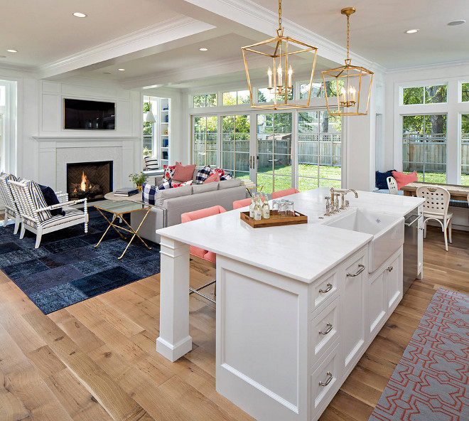White Kitchen Island with White Oak Hardwood. The kitchen countertop is Dover White Italian Marble. White Kitchen Island with White Oak Hardwood flooring. #WhiteKitchenIsland #WhiteOakHardwood #WhiteOakHardwoodFloor Martha O'Hara Interiors. John Kraemer & Sons