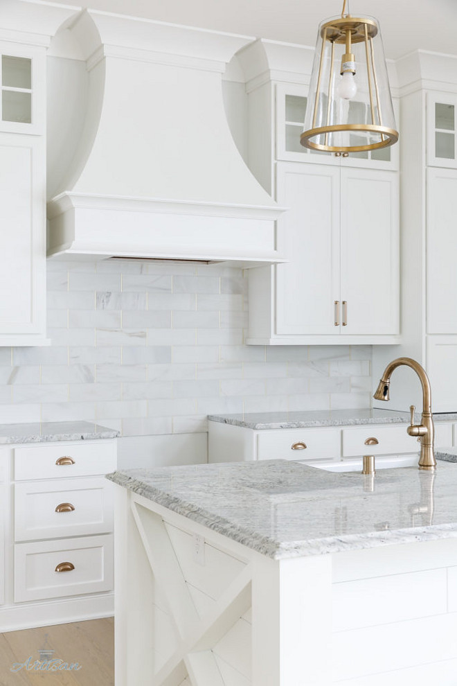 White kitchen with white and grey granite countertop. The countertops are a granite called Salinas. Crisp White kitchen with white and grey granite countertop #Whitekitchen #whiteandgreygranite #whiteandgreygranitecountertop #whitegranite Interior Design by Gretchen Black from Greyhouse Design.