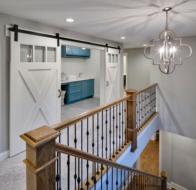 2nd floor laundry room with barn doors, Wall paint color is Benjamin Moore Silver Chain and barn doors are Benjamin Moore White Dove 2nd floor laundry room with barn door ideas, 2nd floor laundry room with barn door layout #2ndfloorlaundryroom #laundryroombarndoor #laundryroombarndoor #laundryroombarndoorideas #laundryroom #barndoors Grace Hill Design