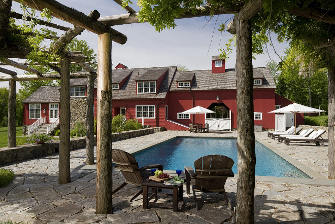 A rustic pergola provides a shady spot beside the pool, Barn style home backyard ideas #barnstylehome #barn #redbarn #pool #backyard #rusticpergola Haver & Skolnick LLC Architects
