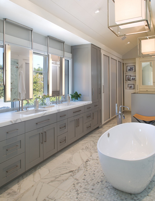 Bathroom with grey cabinet, oval freestanding tub and ceiling mounted mirrors, The mirrors are from a company called Electric Mirror, Stunning Bathroom with grey cabinet, oval freestanding tub and ceiling mounted mirrors, Bathroom with grey cabinet, oval freestanding tub and ceiling mounted mirrors, #Bathroom #bathroomcabinet #greycabinet #ovalfreestandingtub #ceilingmountedmirrors #mountedmirror Christian Rice Architects, Inc. McCormick & Wright