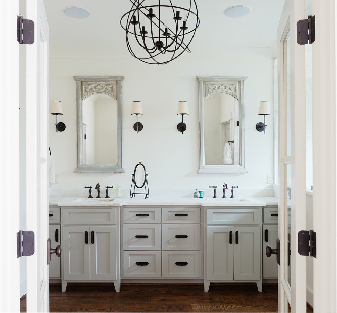 Bathroom with oil rubbed bronze lighting, oil rubbed bronze hardware and oil rubbed bronze faucets. Cabinet paint color is Benjamin Moore OC-52 Gray Owl. #Bathroom #oilrubbedbronze #oilrubbedbronzelighting #oilrubbedbronzehardware #oilrubbedbronzefaucets Willow Homes