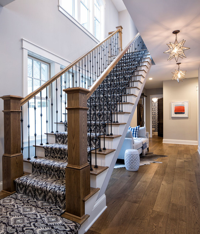 Beautiful open staircase with patterned carpet and wrought iron spindles leading to the 2nd floor #openstaircase #patternedcarpet #stairrunner #wroughtironspindles Grace Hill Design