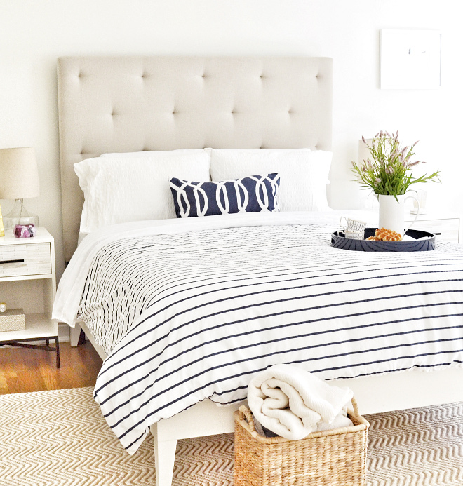 Bedroom Accent Color. Neutral Bedroom with white and navy accents Bedroom. Wall paint color is Benjamin Moore Swiss Coffee. Accent Color ideas #paintcolor #BenjaminMooreSwissCoffee #bedroom #bedding #accentcolor #bedroomaccentcolor Beautiful Homes of Instagram @HomeSweetHillcrest