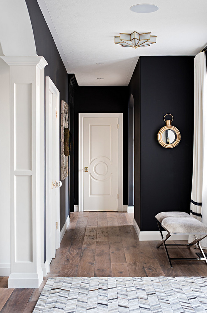 Benjamin Moore Onyx.. Black and white interiors. The black wall paint color is Benjamin Moore Onyx. Benjamin Moore Onyx The black wall paint color is Benjamin Moore Onyx. White trim paint color is Benjamin Moore Swiss Coffee #BenjaminMooreOnyx Sarah St. Amand Interior Design, Inc