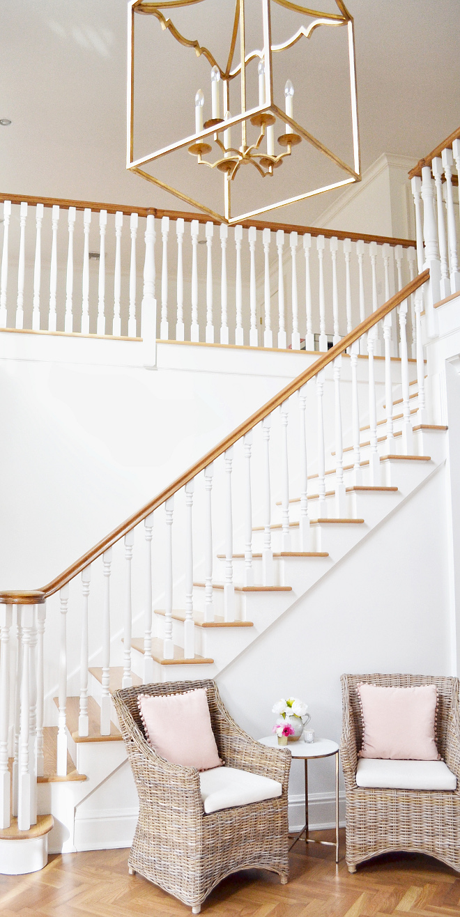 Benjamin Moore Simply White. Walls, trim and staircase spindles paint color is Benjamin Moore Simply White. I chose the same color for the walls and moldings in this white because I like its crisp clean look #BenjaminMooreSimplyWhite Beautiful Homes of Instagram @HomeSweetHillcrest
