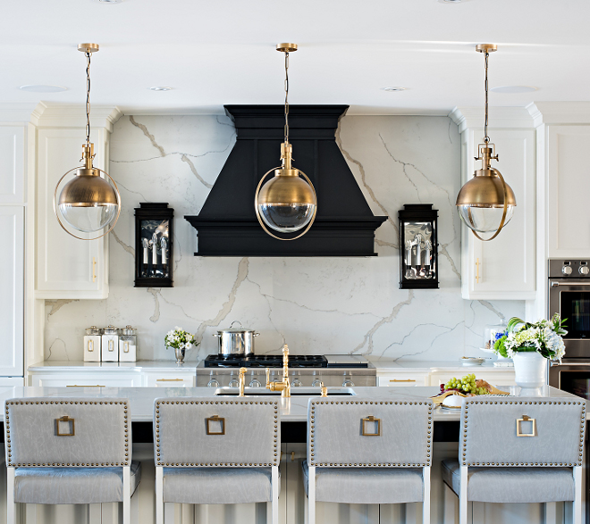 Brass Kitchen Lighting. Kitchen features brass and glass orb pendants. Brass Kitchen Lighting. Kitchen with brass lighting. Kitchen with brass lighting #Kitchen #brasslighting #kitchenlighting #lighting #Kitchen #brass #glass #orbpendants Sarah St. Amand Interior Design, Inc