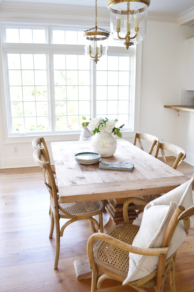 "Breakfast Room. Breakfast area has a pair of Thomas O'Brien Merchant Pendants in Brass from Circa Lighting. Both the table and chairs are from Restoration Hardware. The table is the 60"" Salvaged Wood Trestle Rectangular Table. Madeleine Chairs in Weathered Oak #breakfastRoom #breakfastRoomLighting #breakfastRoomTable #breakfastRoomChairs #breakfastRoomideas Beautiful Homes of Instagram @HomeSweetHillcrest"