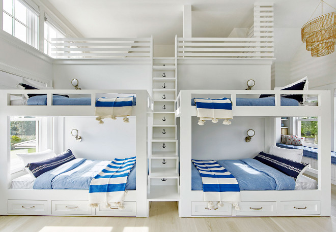 Bunk room with loft, Bunk room with four beds, storage under bunk beds and a built in ladder between bunk beds to a loft #Bunkroom #Loft #Bunkroomloft #fourbunkbeds #bunkbedstorage #bunkroomladder #bunkbedladder #builtinladder Chango & Co