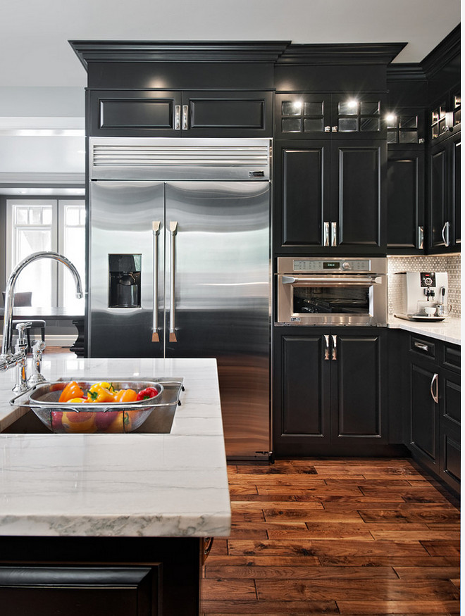 Ebony Kitchen Cabinets. Kitchen with ebony black cabinets and white marble countertop. Ebony is a sealer with black pigment in it applied in two coats and then top coated with a lacquer. #EbonyKitchen #EbonyCabinets #Kitchen #ebony #kitchen #blackcabinets #whitemarblecountertop Laurysen Kitchens Ltd