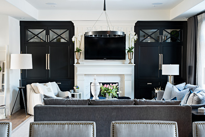 Family room with black built in cabinets painted in Benjamin Moore Onyx. Benjamin Moore 2133-10 Onyx #BenjaminMoore213310Onyx #BenjaminMooreOnyx Sarah St. Amand Interior Design, Inc