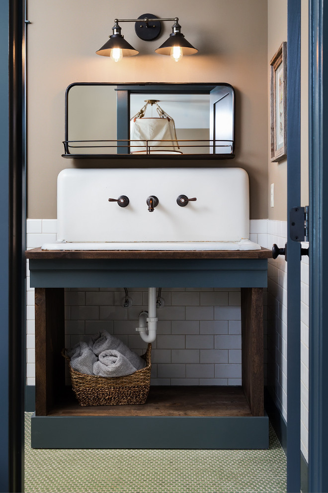 "Farmhouse Bathroom Vanity. Farmhouse Bathroom Vanity. This farmhouse bathroom features a 42"" wide vintage sink  Paint color is Down Pipe by Farrow & Ball. Farmhouse Bathroom with navy blue and reclaimed wood vanity. Farmhouse Bathroom Vanity #FarmhouseBathroom #FarmhouseVanity #Farmhouse Willow Homes"