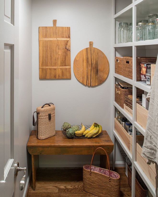 Farmhouse Pantry. Farmhouse Pantry. In this farmhouse pantry, open pantry shelves stocked with wicker baskets and hanging wooden cutting boards make it easy for everyone to help with meal preparations. Farmhouse Pantry. Grey Farmhouse Pantry. #FarmhousePantry #Pantry Anthony Wilder Design/Build, Inc