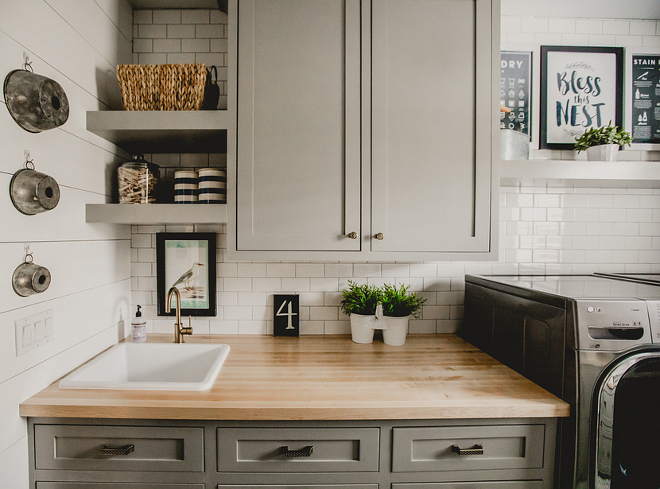 Farmhouse laundry room with grey cabinets, shiplap walls, white subway tile and Ikea butcher's block countertop. Cabinets are custom built maple, shaker style. Farmhouse laundry room #farmhouselaundryroom #farmhouse #laundryroom Beautiful Homes of Instagram @house.becomes.home