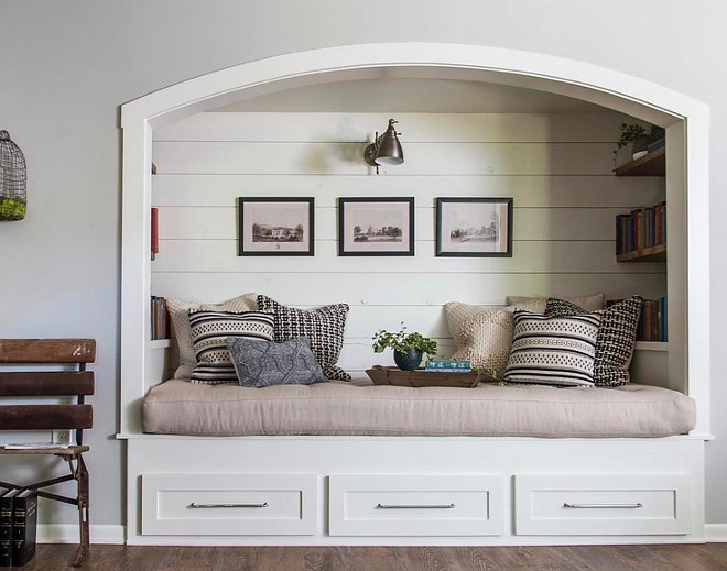 Fixer Upper Farmhouse Reading Nook. Farmhouse Reading Nook with shiplap paneling and reclaimed wood bookshelves. Reading Nook. HGTV's Fixer Upper Farmhouse Reading Nook #FixerUpper #Farmhouse #ReadingNook #FixerUpperFarmhouseReadingNook #ReadingNook #Farmhouse