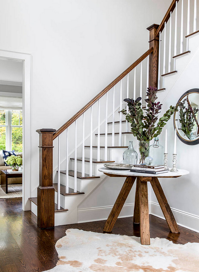 Foyer Table. Farmhouse inspired foyer with light gray walls, stained oak hardwood floors and trestle table. Table is Roost Sandblasted Marble Table #trestletable #foyertable #farmhousefoyer #farmhouse Kennerknecht Design Group