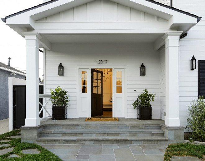 Front Porch. Cape Cod Home with Pediment style porch. Modern Cape Cod Home with Pediment style porch. Modern Cape Cod home with pediment style porch and Bluestone walkway #ModernCapeCod #capecodhome #pedimentstyleporch #porch #Bluestone #stonewalkway Hamilton Architects