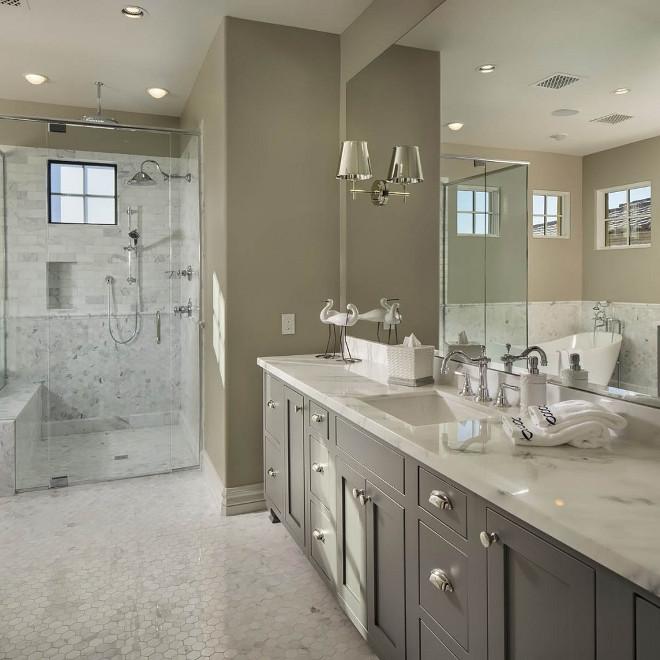 Greige Bathroom with grey vanity and curbless walk-in shower. Flooring is Hex Kacy Polished Marble. Light Greige Bathroom with grey vanity and curbless walk-in shower. Greige Bathroom. Curbless Shower #GreigeBathroom #greyvanity #curblesswalkinshowe #curblessshower #walkinshower #Flooring #Hextile #KacyPolishedMarble #kacymarble Luster Custom Homes & Remodeling