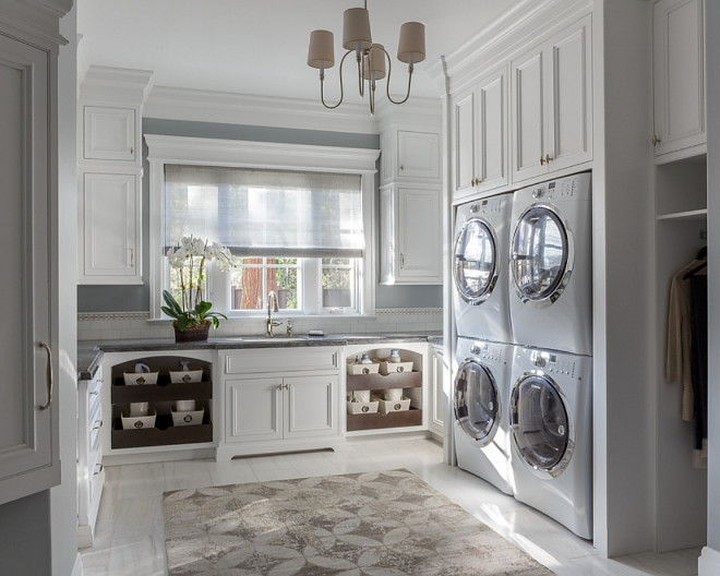 Laundry room with with stacked double washer and dryer, laundry chute and floor to ceiling cabinets, Large Laundry room with with stacked double washer and dryer, laundry chute and floor to ceiling cabinets #Laundryroom #Largelaundryroom #stackeddoublewasheranddryer #stackedwasheranddryer #doublewasheranddryer #laundrychute #cabinets Spectrum Interior Design, Inc