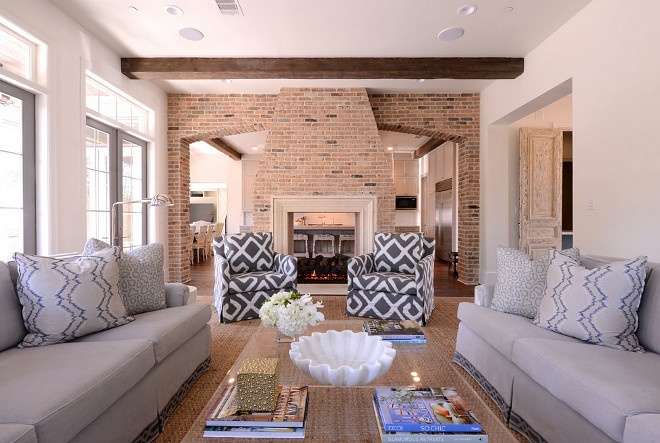 Living room with open brick fireplace dividing family room from kitchen. Living room with open brick fireplace dividing family room from kitchen ideas. Living room with open brick fireplace dividing family room from kitchen. Living room with open brick fireplace dividing family room from kitchen #Livingroom #openbrickfireplace #brickfireplace #familyroom #kitchen Munger Interiors