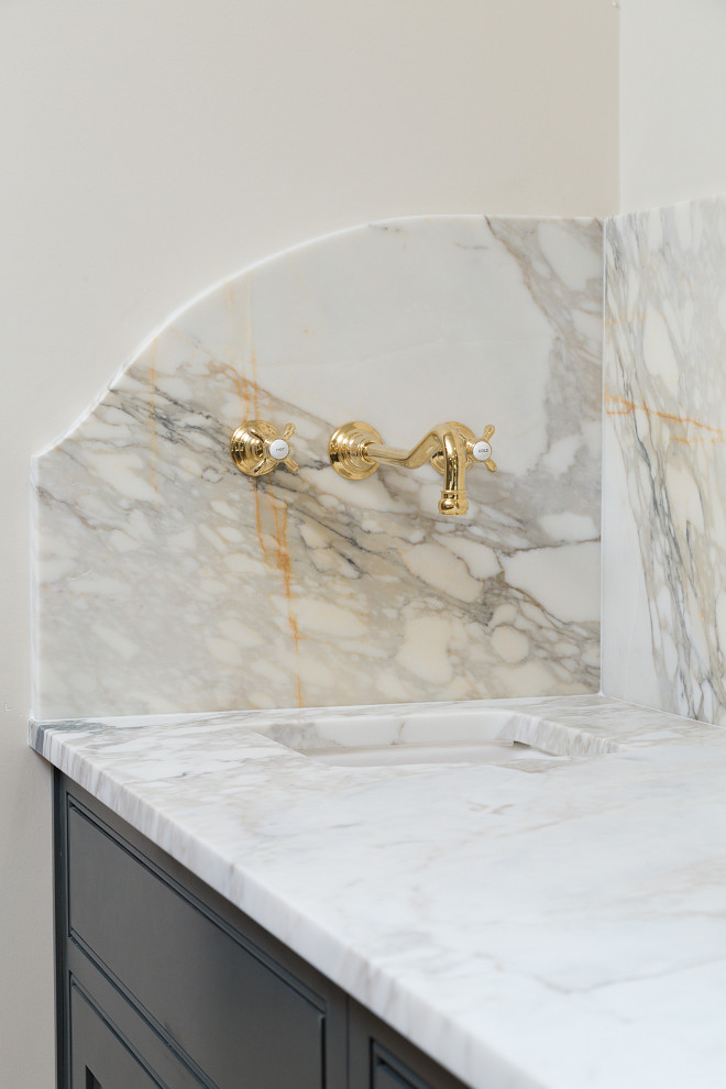 Marble slab countertop and Marble slab backsplash with wall-mounted brass faucet Willow Homes
