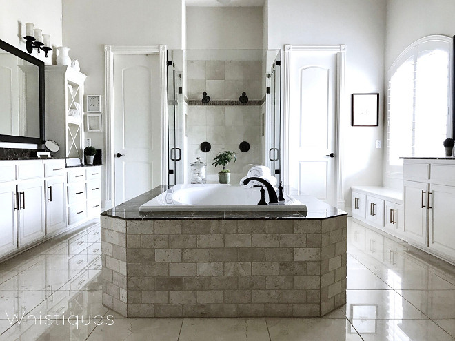 Master Bathroom. Classic Master Bathroom. Tub stone tile is Daltile/Plateau Warm Beige; Daltile/Emperador Dark. Master Bathroom. Master Bathroom #MasterBathroom Beautiful Homes of Instagram @whistiques