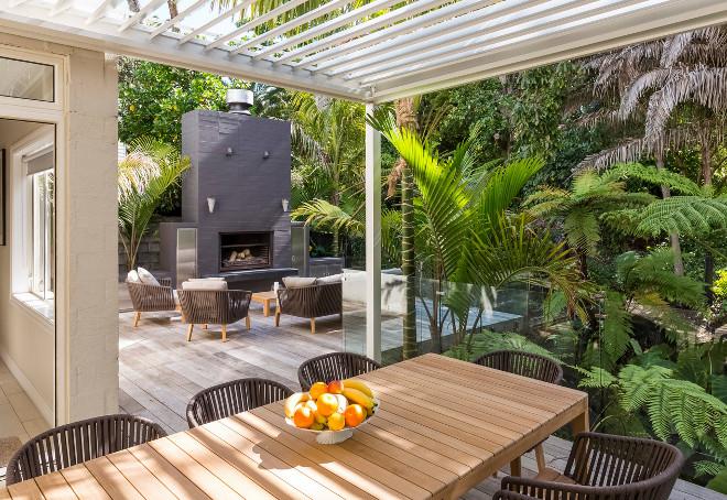 Metal Pergola Large deck with metal pergola and brick fireplace #MetalPergola Landscaping New Zealand