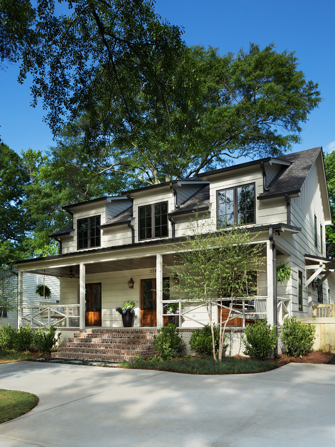 Modern Farmhouse with front porch. The off-white exterior paint color is Old White by Farrow and Ball. Gutters are Dark Bronze by Farrow and Ball also. Modern Fixer Upper Farmhouse with front porch. Modern Fixer Upper Farmhouse with front porch. Modern Fixer Upper Farmhouse with front porch ideas #ModernFixerUpperFarmhouse #FixerUpperFarmhouse #ModernFarmhouse #frontporch Willow Homes