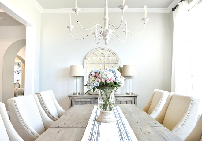 Neutral Farmhouse Dining Room. Neutral Farmhouse Dining Room. Gorgeous neutral farmhouse dining room. The distressed French chandelier is from Visual Comfort. Neutral Farmhouse Dining Room. Neutral Farmhouse Dining Room. Neutral Farmhouse Dining Room #NeutralFarmhouse #FarmhouseDiningRoom My Texas House @MyTexasHouse