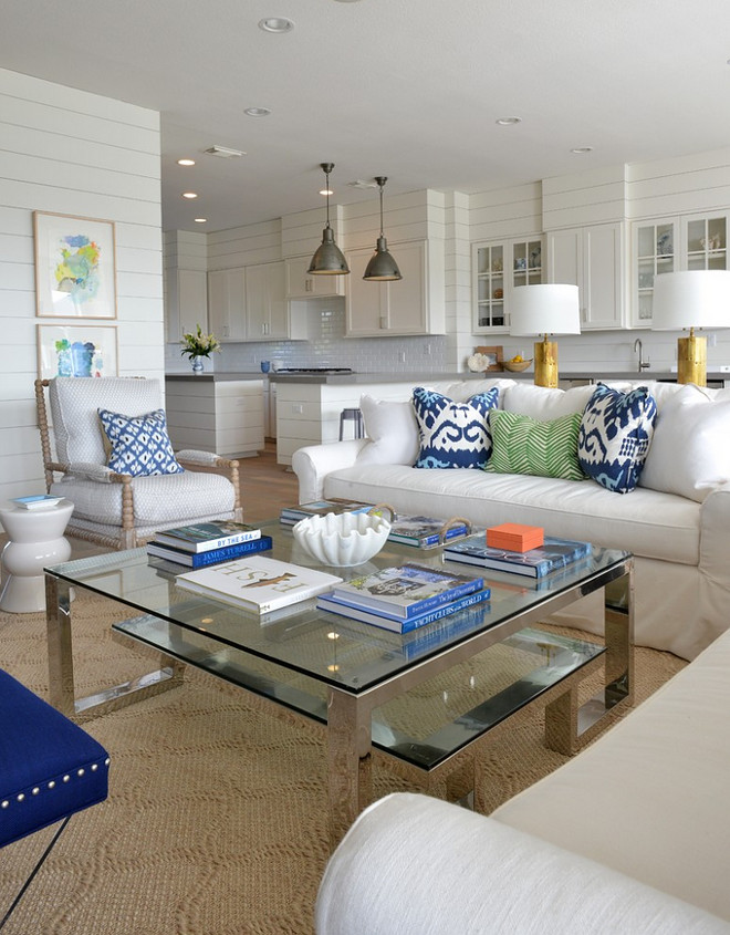 Open living room with shiplap paneled walls. Shiplap paneling surrounds this open coastal home. Open living room with shiplap paneled wall ideas. Open living room with shiplap paneled walls #Openlivingroom #shiplap #Shiplappaneling #paneledwalls