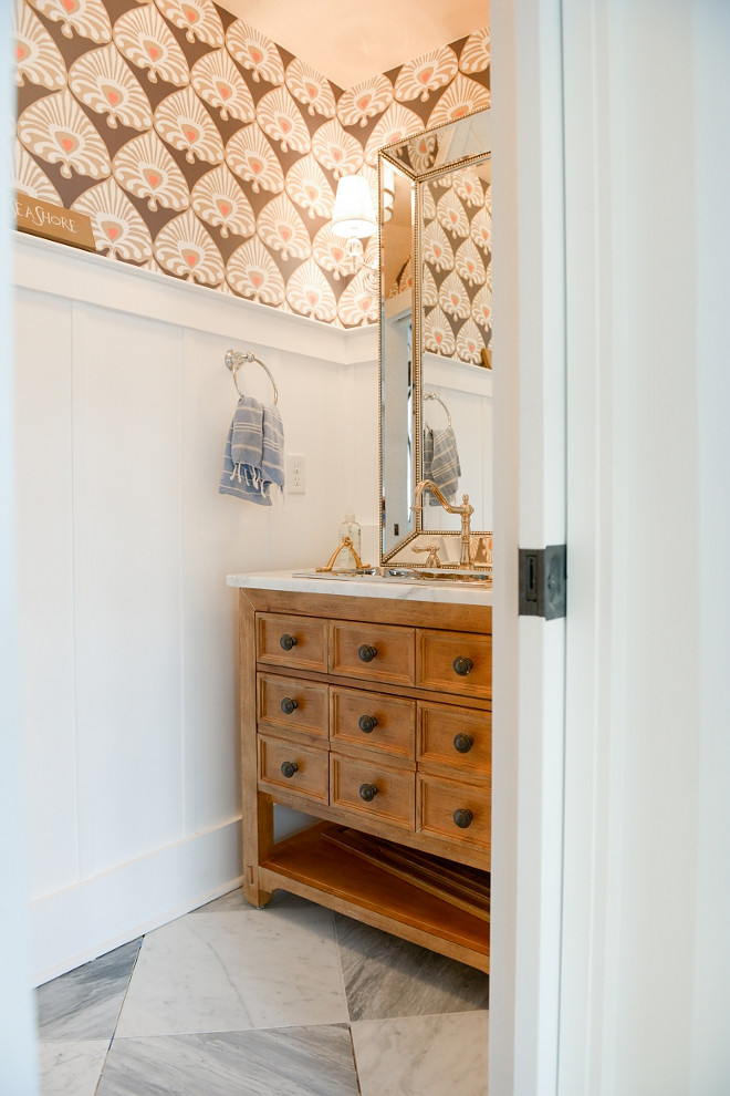 Powder Room Wainscotting. A warm wallpaper brings some extra character to this powder room with board and batten wainscoting. Powder Room Wainscotting. Powder Room Wainscotting. Powder Room Wainscotting #PowderRoomWainscotting #PowderRoom #Wainscotting #Boardandbatten Echelon Custom Homes
